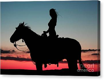 Sunset Ride Canvas Print by Val Armstrong
