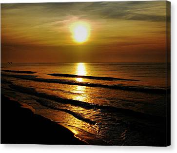 Sunset Waves Canvas Print by Colin Clancy