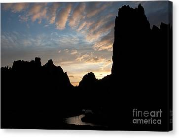 Sunset With Rugged Cliffs In Silhouette Canvas Print