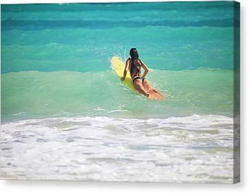 Surfer Girl Paddling Out Canvas Print by Tomas Del Amo - Printscapes
