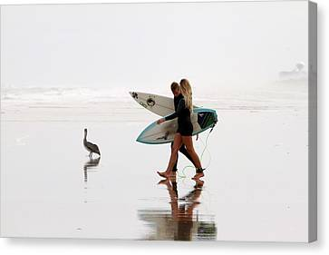 Canvas Print featuring the photograph Surfers And A Pelican by Alice Gipson