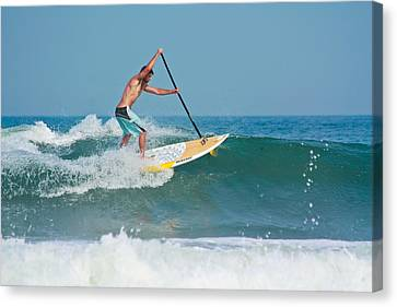 Surfing And Paddling Canvas Print by Ann Murphy