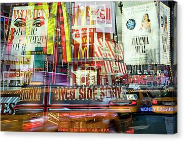 Surrounded By Times Square At Twilight Canvas Print by Travelif