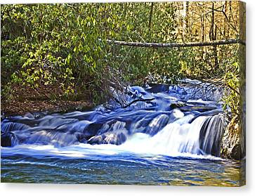 Canvas Print featuring the photograph Swiftly Flowing River by Susan Leggett
