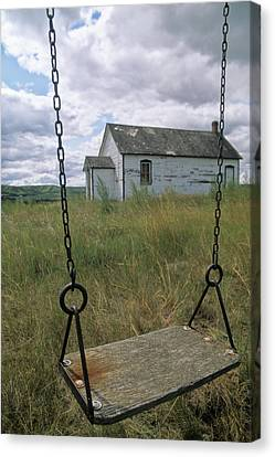 Swing At Old School House, Quappelle Canvas Print by Dave Reede