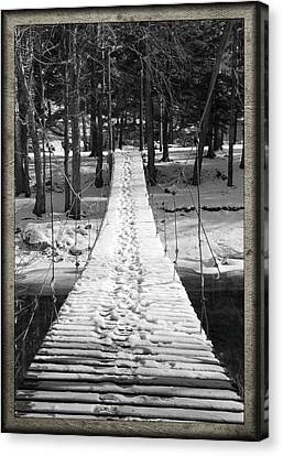 Swinging Cable Foot Bridge Canvas Print by John Stephens
