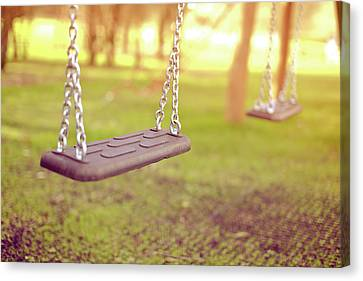 Swings In Park Canvas Print by Rob Webb