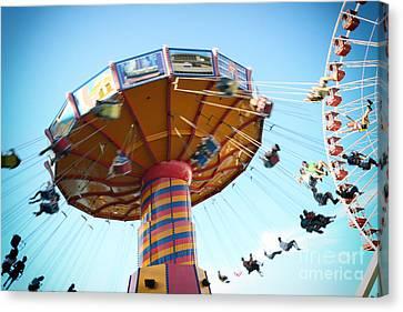 Swings Canvas Print by Leslie Leda