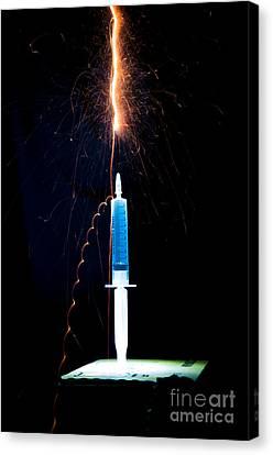 Syringe Disperses Lighting Canvas Print by Guy Viner