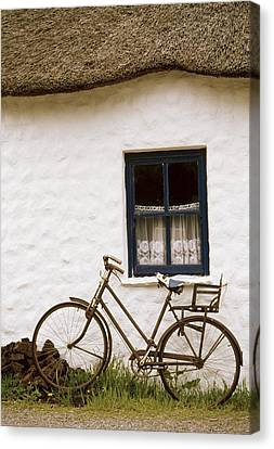 Tahtched Cottage And Bike Canvas Print by Richard Cummins