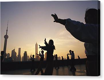 Tai Chi On The Bund In The Morning Canvas Print by Justin Guariglia
