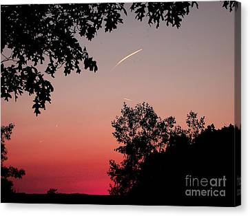 Canvas Print featuring the photograph Tails Of Light At Sunset by Christian Mattison