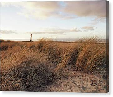 Clouds Over Sea Canvas Print - Talacre Beach And Point Of Arye Lighthouse by Jon Baxter