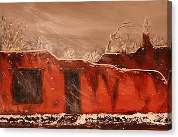 Taos Pueblo In The Snow Canvas Print by Robert Handler