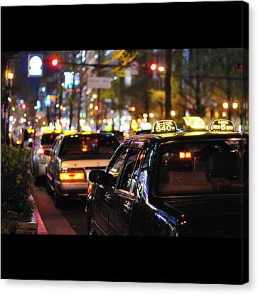 Taxis On Street At Night Canvas Print by Thank you for choosing my work.