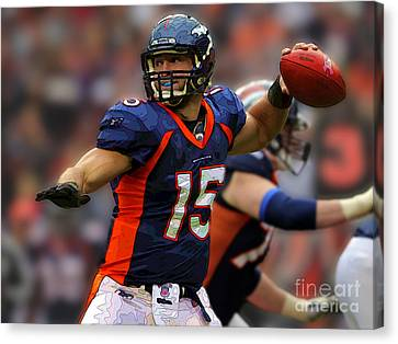 Tebow At Denver Broncos Canvas Print by Herb Paynter