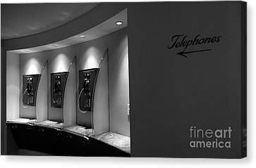 Canvas Print featuring the photograph Telephones On Wall by Nina Prommer