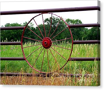 Canvas Print featuring the photograph Texas Wildflowers Through Wagon Wheel by Kathy  White