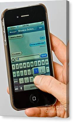 Texting On An Iphone Canvas Print by Photo Researchers