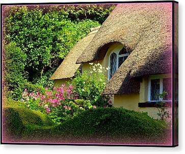 Thatched Cottage With Pink Flowers Canvas Print by Carla Parris