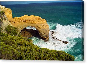 Canvas Print featuring the photograph The Arch With Breaking Wave by Dennis Lundell