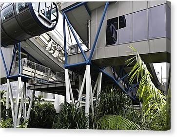 The Area Below The Capsules Of The Singapore Flyer Canvas Print by Ashish Agarwal