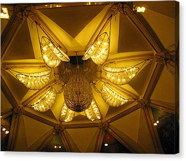 The Beautifully Lit Chandelier On The Ceiling Of The Iskcon Temple In Delhi Canvas Print by Ashish Agarwal