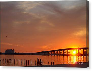 The Biloxi Bay Bridge At Sunset Canvas Print by David R Frazier and Photo Researchers