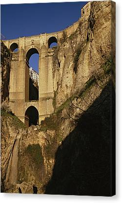 The Bridge At Ronda Spain Connects Canvas Print by Stephen Alvarez