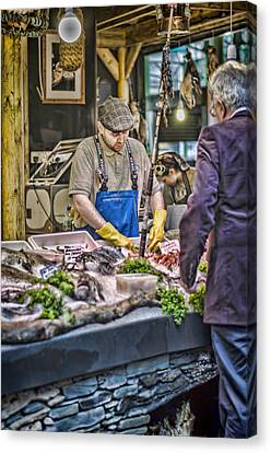 The Fish Monger Canvas Print by Heather Applegate