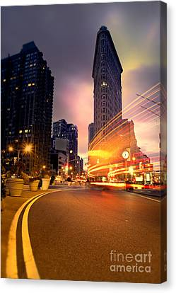 The Flat Iron Building With Some Magic Happening Canvas Print by John Farnan