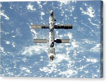 The International Space Station Is Seen Canvas Print by Everett