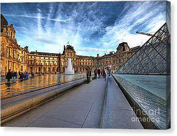 The Louvre Paris Canvas Print by Charuhas Images