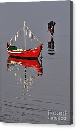 The Man And The Boat Canvas Print by Armando Carlos Ferreira Palhau