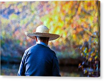 The Man In The Straw Hat Canvas Print by Ann Murphy