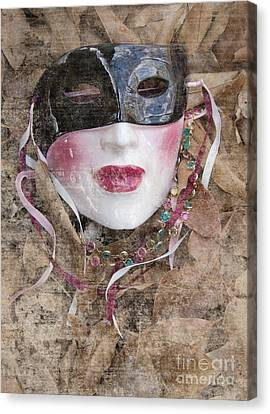 The Mask In The Leaves Canvas Print by Carolyn Fox