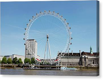 The Millennium Wheel And Thames Canvas Print by Richard Newstead