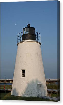 The Moon Behind The Piney Point Lighthouse Canvas Print by Bill Cannon