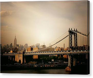 The New York City Skyline And Manhattan Bridge At Sunset Canvas Print by Vivienne Gucwa