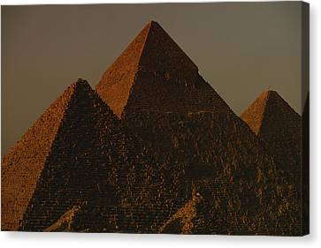 The Pyramids Of Giza In The Late Canvas Print by Kenneth Garrett