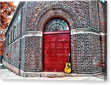 The Red Door And The Guitar Canvas Print