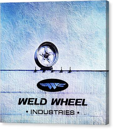 The Rim At Weld Wheels Industries  Canvas Print by Andee Design