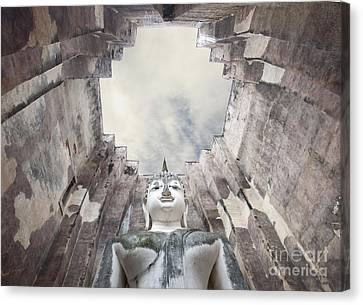 The Sculpture Of Buddha And Blue Sky In Historical Park Thailand  Canvas Print by Anek Suwannaphoom