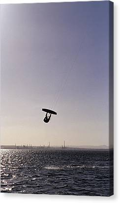 The Silhouette Of A Person Kite Canvas Print by Jason Edwards
