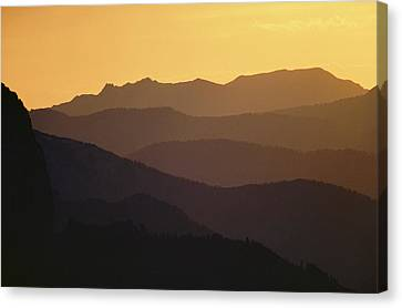 The Silhouetted Mountains Range In Hues Canvas Print by Michael S. Quinton