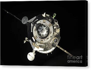The Soyuz Tma-17 Spacecraft Departs Canvas Print by Stocktrek Images