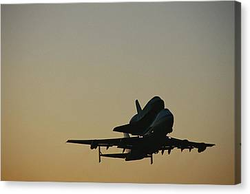 The Space Shuttle Atlantis Piggyback Canvas Print by Marc Moritsch