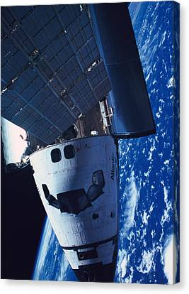 The Space Shuttle Docked With A Space Station Canvas Print by Stockbyte