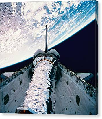 Separation Canvas Print - The Space Shuttle With Its Open Cargo Bay Orbiting Above The Earth by Stockbyte