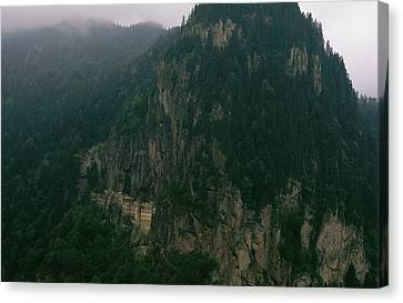 The Sumela Monastery Clings To Mountain Canvas Print by Randy Olson